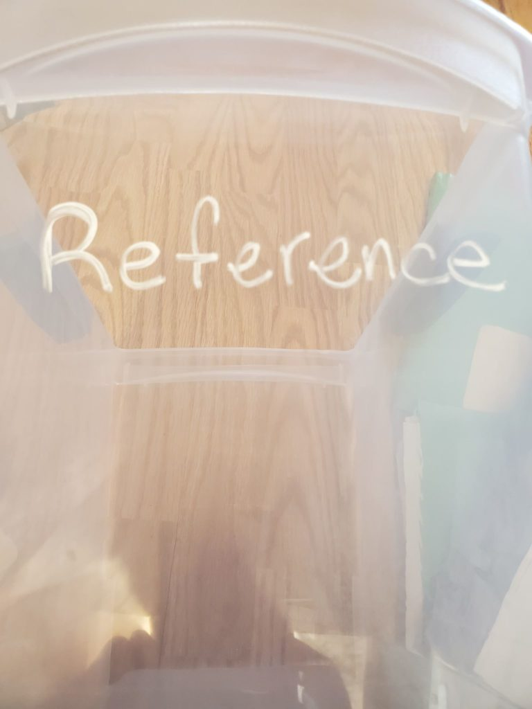 image of clear plastic container for reference papers