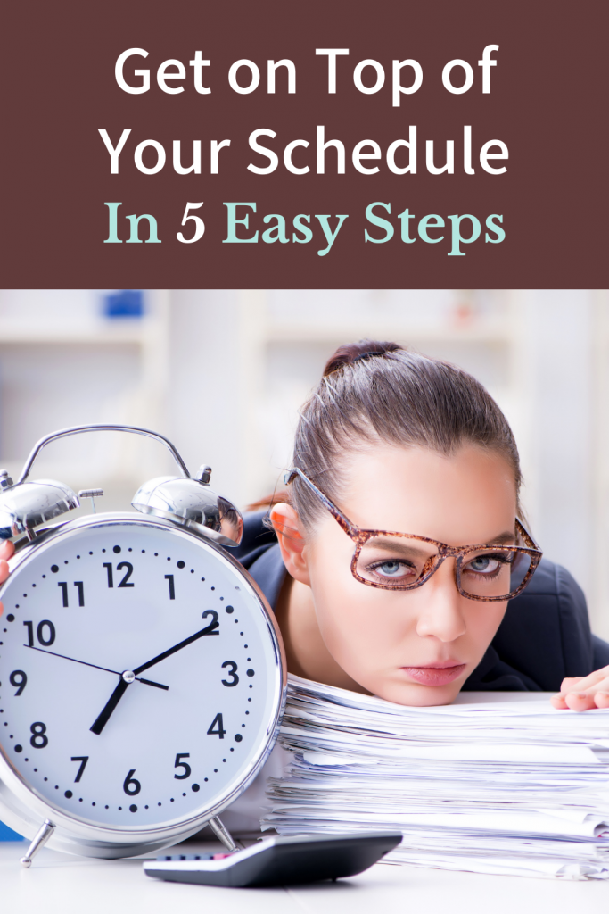 time management - get on top of your schedule in 5 easy steps woman resting her chin on a stack of papers next to a big clock