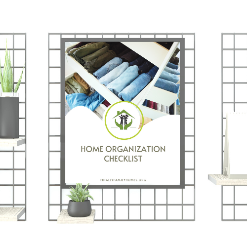 """paper hanging on a board that says """"home organization checklist"""""""
