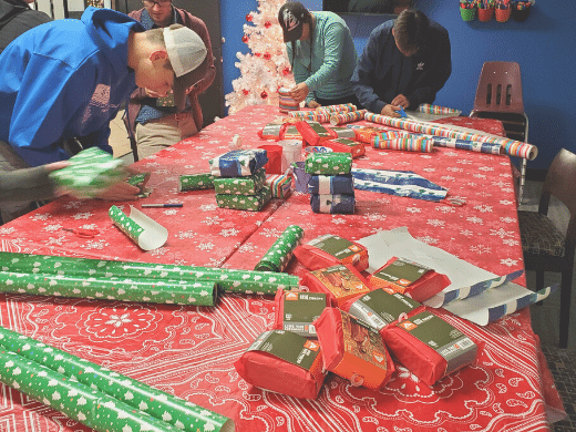 youth volunteering to wrap gifts for former foster youth