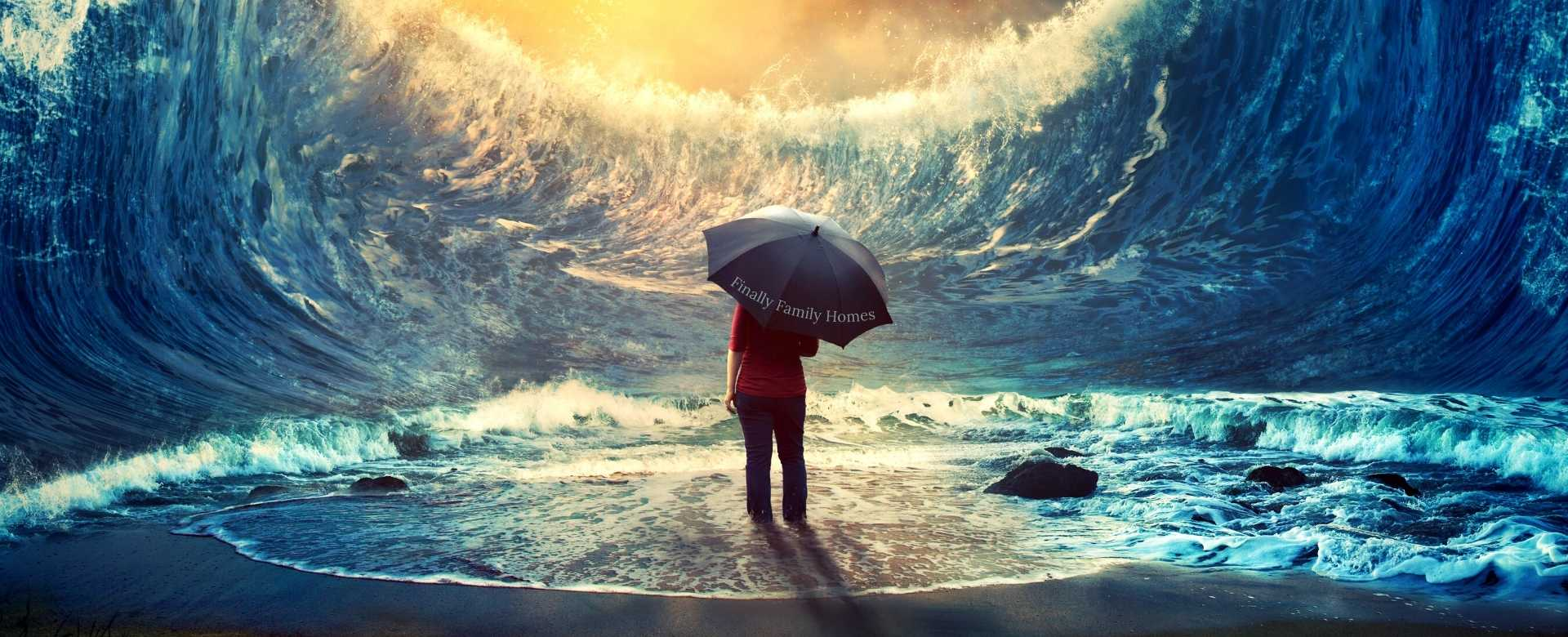 young woman standing in the middle of tall waves holding an umbrella