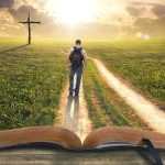bible verses about hope represented as man walking on a path through the bible to the cross